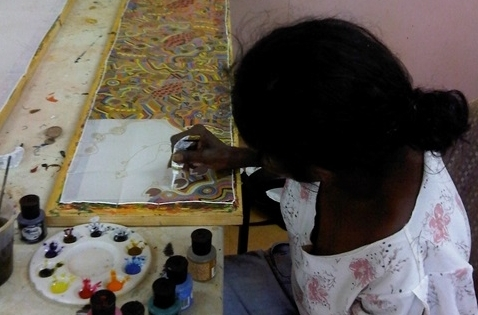 Artist Barbara Richards working on a silk painting. © Jacky Cheng of KTI 2014
