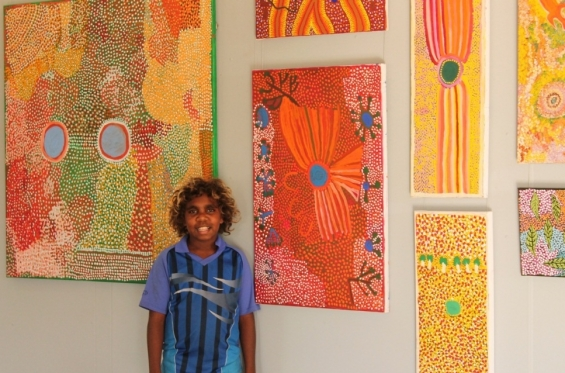 Hussani with paintings by Kuji Rosie Goodjie © Ngurra Arts 2014