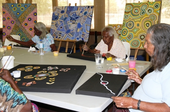 (L to R) Luku Trancollino, Tiny Macale & Bonnie Deegan painting at Yarliyil Art Centre. © AGWA 2014