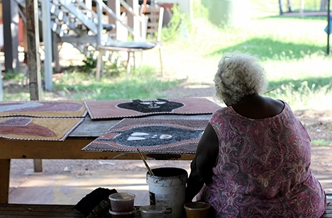 Artist Phyllis Thomas painting joonba boards at the Warmun Art studio, Warmun. © Alana Hunt & Warmun Art