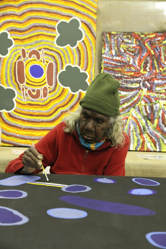 Artist Lulu Trancollino painting at Yarliyil art centre. © Art Gallery of Western Australia 2013