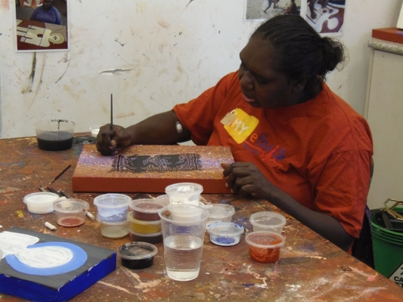 Artist Kirsty Burgu painting at the Mowanjum studio © Chad Creighton & AGWA 2013