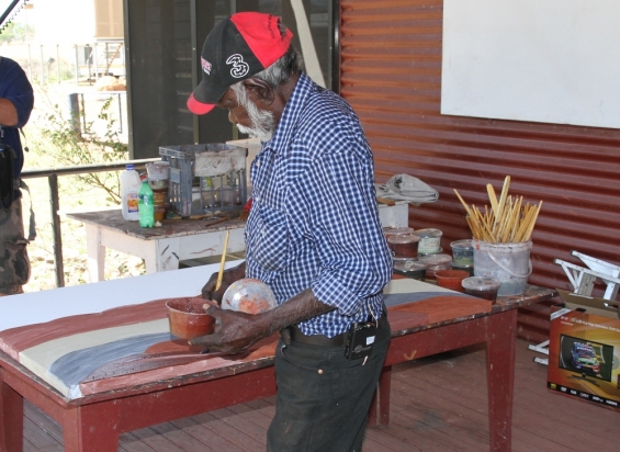 Gordon Barney working on a new painting at Warmun Art Centre. © AGWA 2014