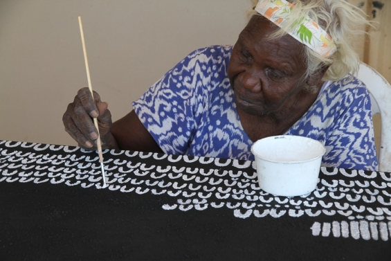 Lena Nyadbi working on a new painting at Warmun Art Centre. © AGWA 2014