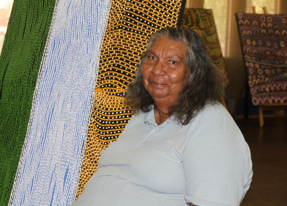 Bonnie Deegan next to one of her paintings at Yarliyil Art Centre. © AGWA 2014