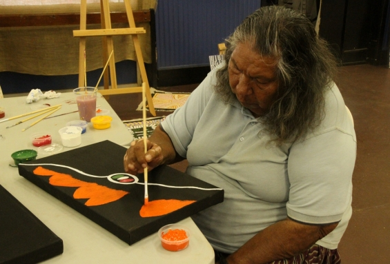 Bonnie Deegan working on a new painting at Yarliyil Art Centre. ©  AGWA 2014