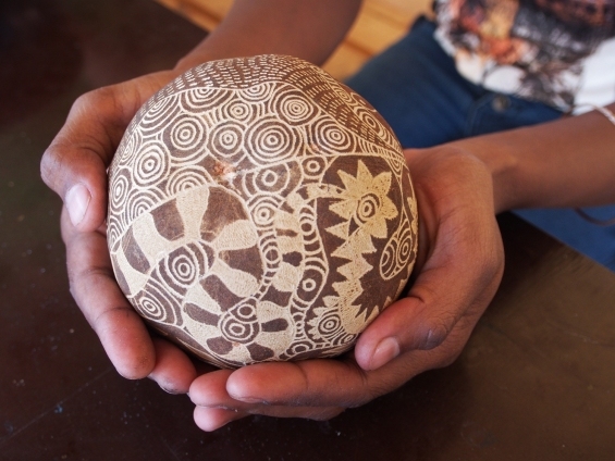 Petrina Bedford holding an engraved boab nut in the Mowanjum studio © AGWA 2015