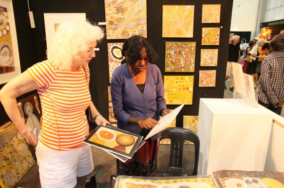 Betty Bundamurra working at the Kira Kiro Art Centre stall at the Darwin Aboriginal Art Fair