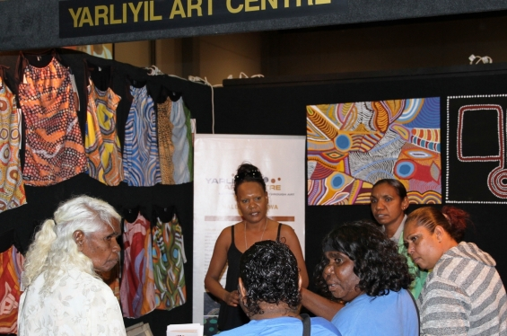 Jeannette Swan working at the Yarliyil Art Centre stall at the Darwin Aboriginal Art Fair