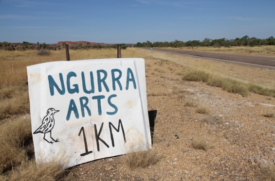 Sign on the side of the Great Northern Highway to the Ngurra Arts turn-off © AGWA 2015