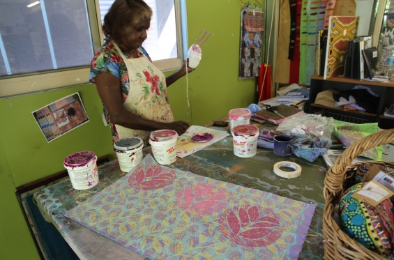 Artist Cherry Smiler mixing paints for fabric printing at Marnin Studio in Fitzroy Crossing © AGWA 2015