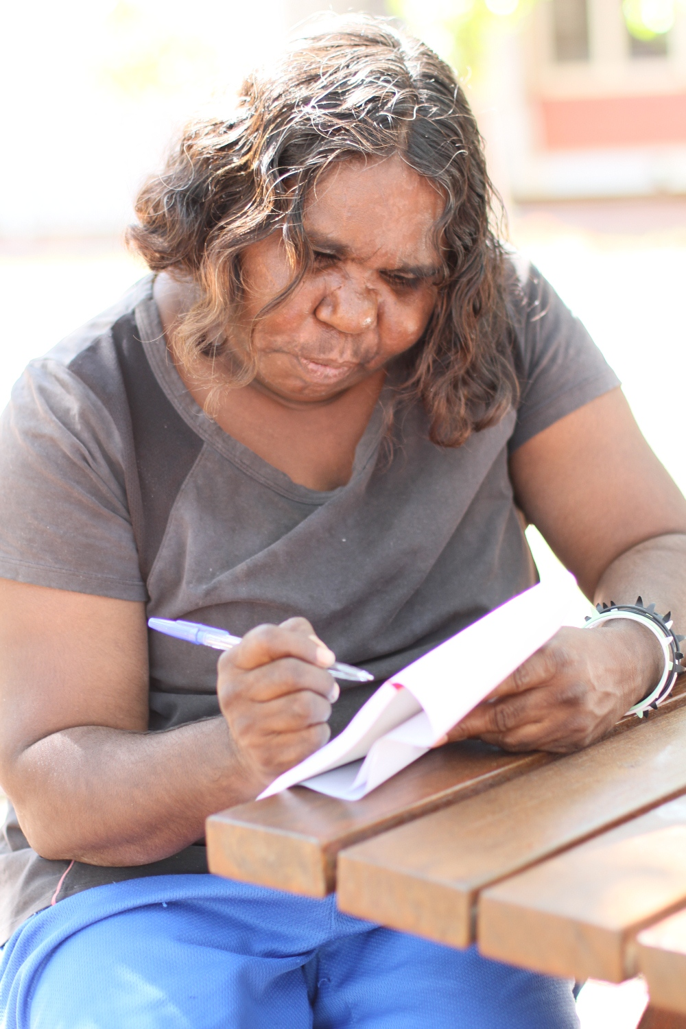 Lillie Spinks composing her voiceover during the practical workshop at the Visual Arts Leadership Program at the University of Notre Dame, Broome © AGWA 2015