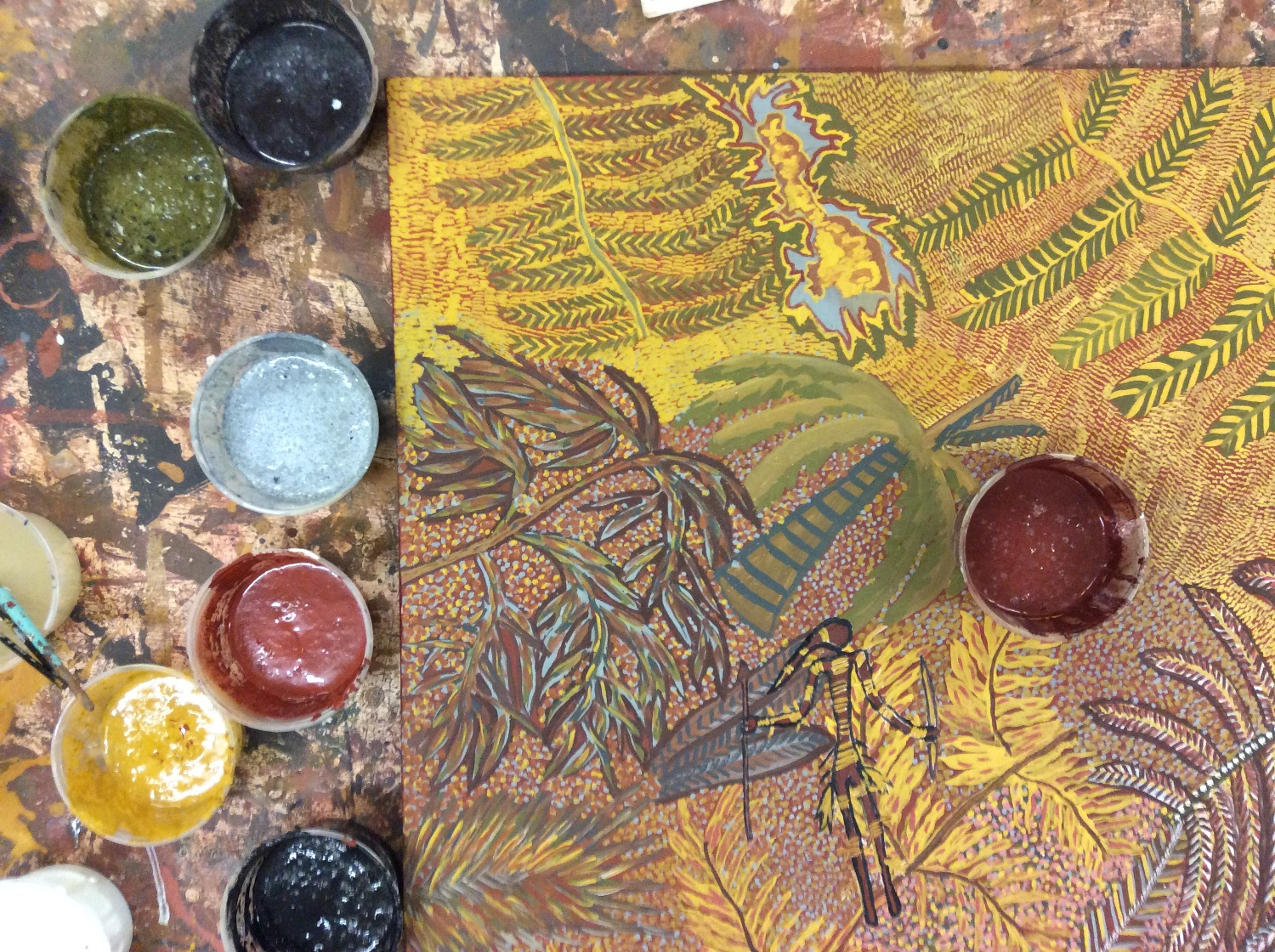 Artwork by Mary Puntji Clement in progress with ochres in the Kira Kiro Art Centre Studio. © AGWA 2015