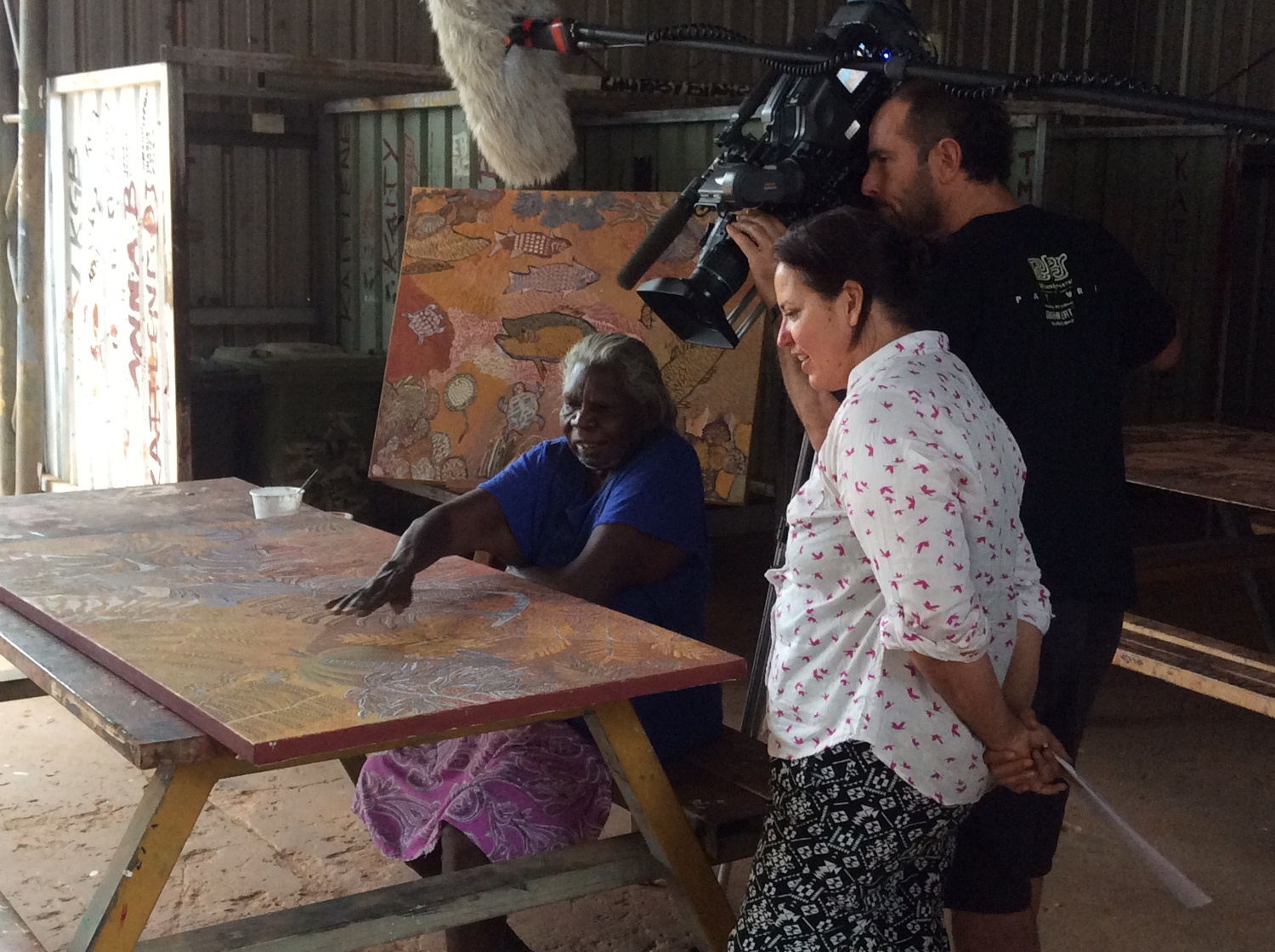 Artist Mary Puntji Clement explaining her artwork to the ICS crew (Camera: Jason Thomas & Director: Jub Clerc) at Kira Kiro Art Centre. © AGWA 2015