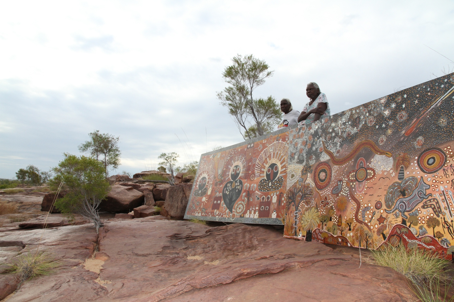 Mary Puntji Clement and Mary Teresa Taylor with collaborative artwork panel at Malinjarr Gorge © AGWA 2015