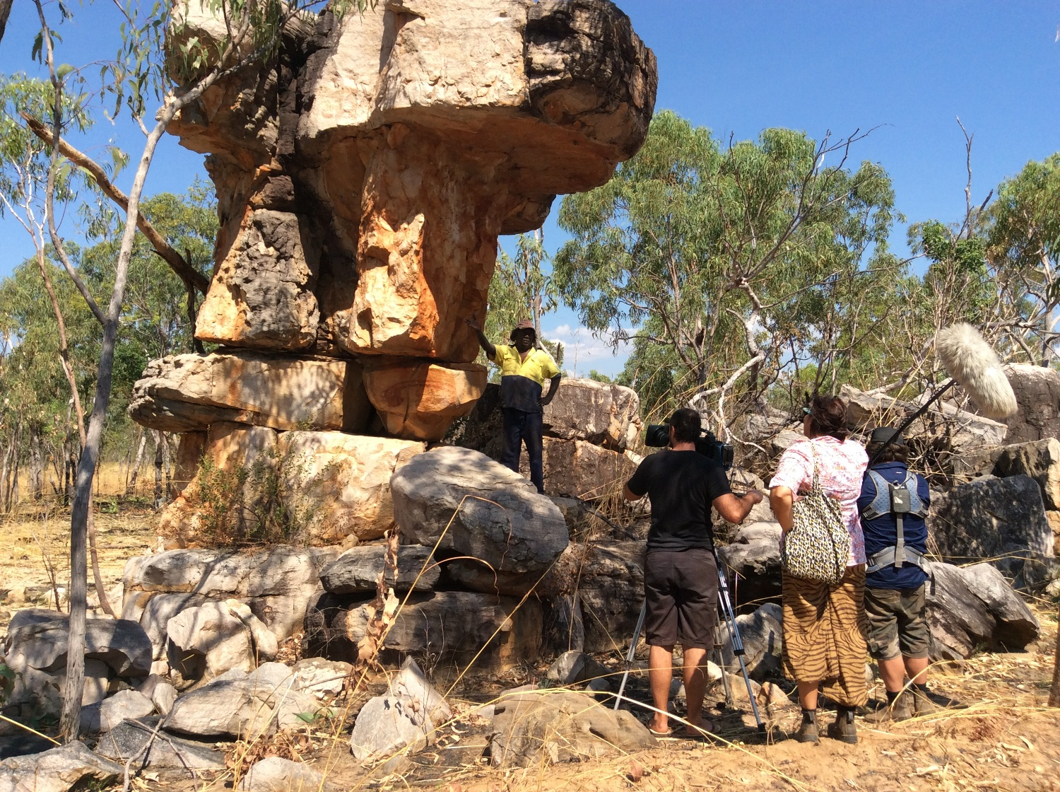 Dennis Bundamurra explaining the shooting star rock art site while being recorded by the ICS crew (Camera: Jason Thomas, Sound: Owen Hughes & Director: Jub Clerc) © AGWA 2015