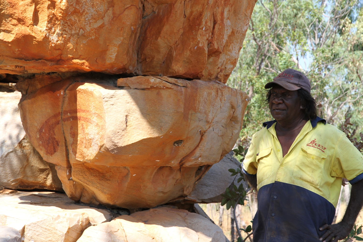 Dennis Bundamurra at the shooting star rock art site. © AGWA 2015