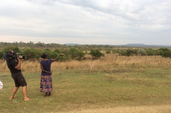 Betty Bundamurra being filmed pointing out the landmarks around Kalumburu. © AGWA 2015