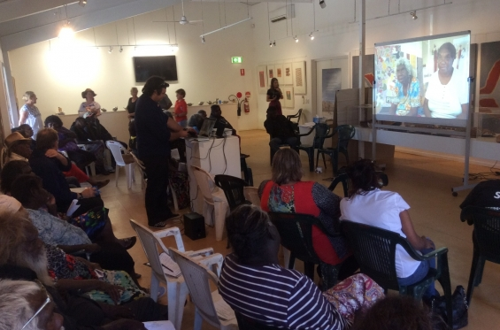 Participants at the 2015 ANKAAA Kimberley Regional Meeting watching the film about Waringarri Arts produced by Desert River Sea & Indigenous Community Stories in the Dawang Gallery © AGWA 2015