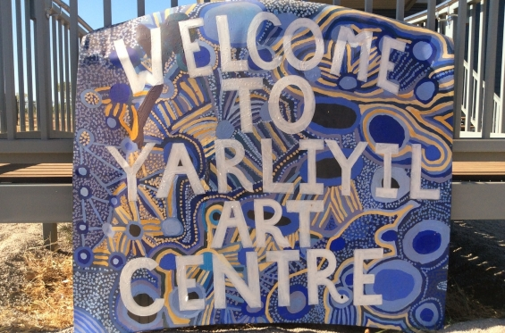 Sign out the front of Yarliyil Art Centre painted by artist Lulu Trancollino © AGWA 2015