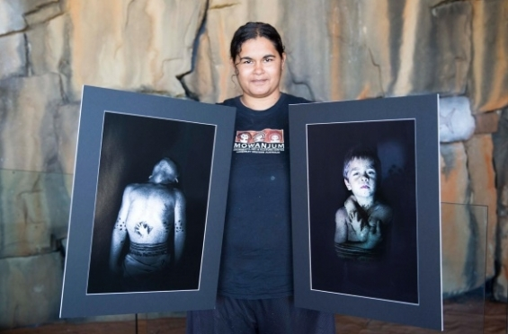 Mary Lou Divilli with her photographs of son Noah. © Mowanjum Art Centre 2015