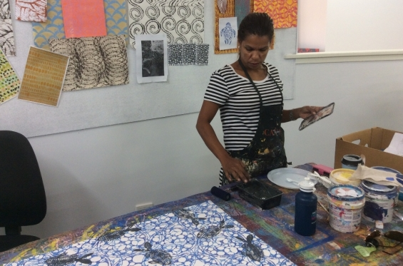 Nagula Jarndu artist Rowena Morgan printing fabric in the studio © AGWA 2015