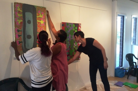 Anthea Nargoodah and Lynley Nargoodah with Carly Lane, AGWA Curator of Aboriginal and Torres Strait Islander Art, hanging paintings for the 2016 Visual Arts Leadership Program exhibition in Kununurra. © Art Gallery of WA 2016