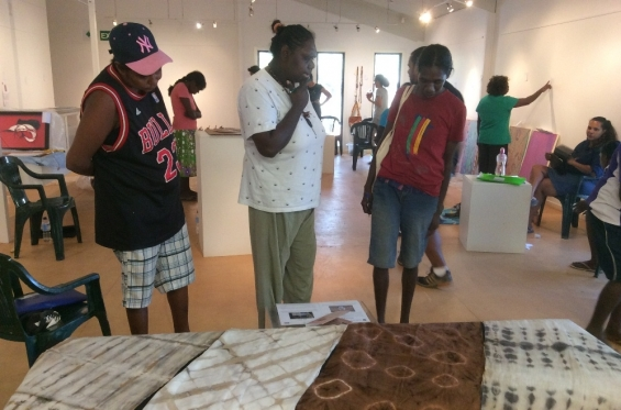 Lutisha Woolagoodja with fellow Visual Arts Leadership Program participants Kirsty Burgu and Nancy Daylight at the 2016 workshop going through the exhibition curating process. © Art Gallery of WA 2016