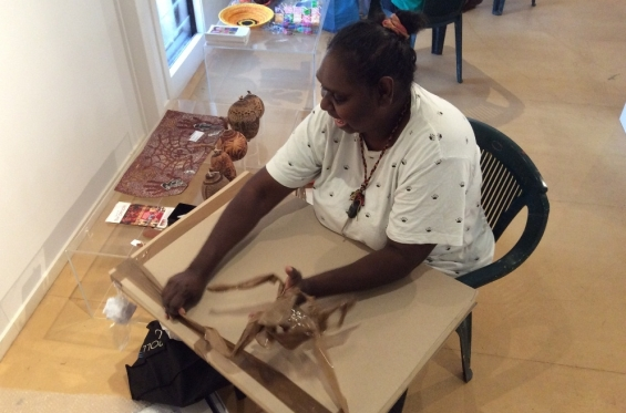 Kirsty Burgu unwrapping paintings during the 2016 Visual Arts Leadership Program workshop. © Art Gallery of WA 2016