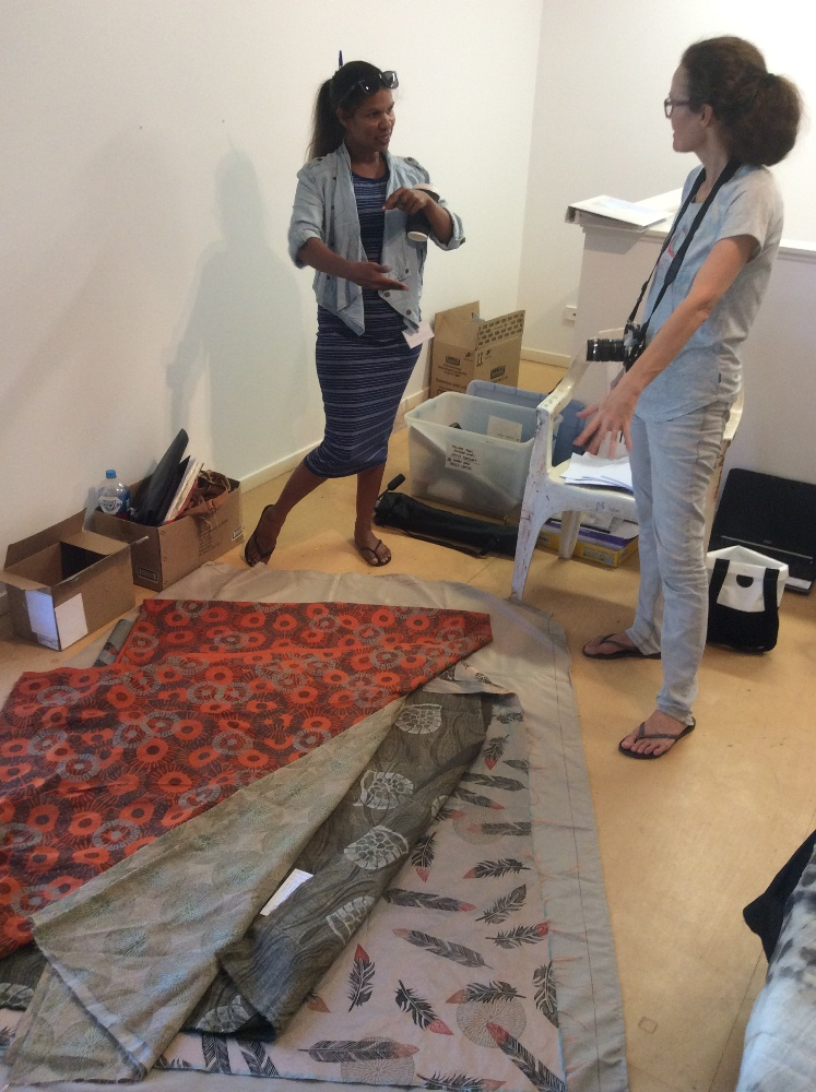 Rowena Morgan telling Desert River Sea Project Coordinator, Philippa Jahn about her hand printed textiles during the 2016 Visual Arts Leadership Program workshop. © Art Gallery of WA 2016