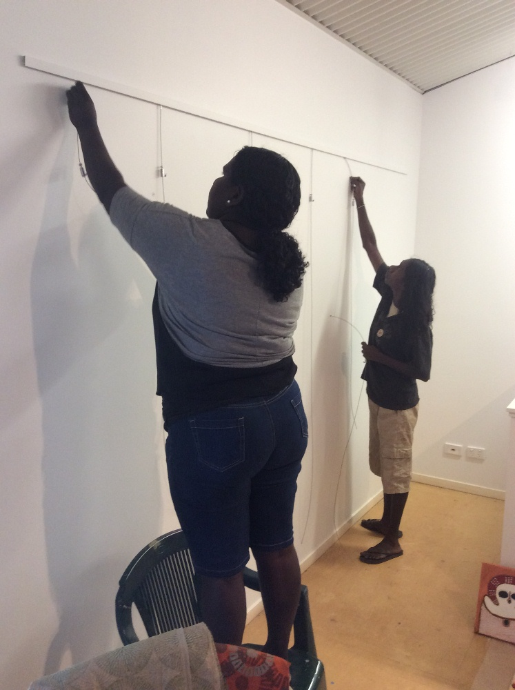Marika Riley with fellow Visual Arts Leadership Program participant Nancy Daylight hanging paintings at the 2016 workshop. © Art Gallery of WA 2016
