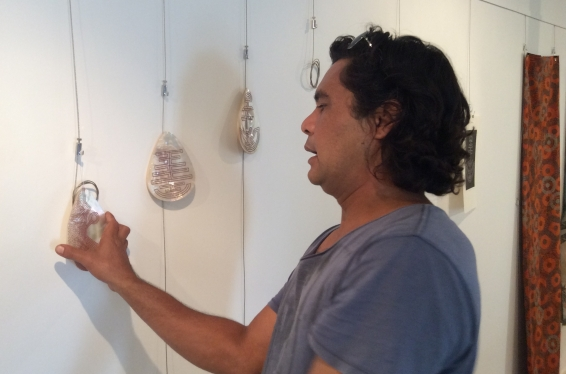Visual Arts Leadership Program participant Garry Sibosado hanging pearl shell artworks during the 2016 curating workshop for the inaugural Desert River Sea exhibition opening in Kununurra © AGWA