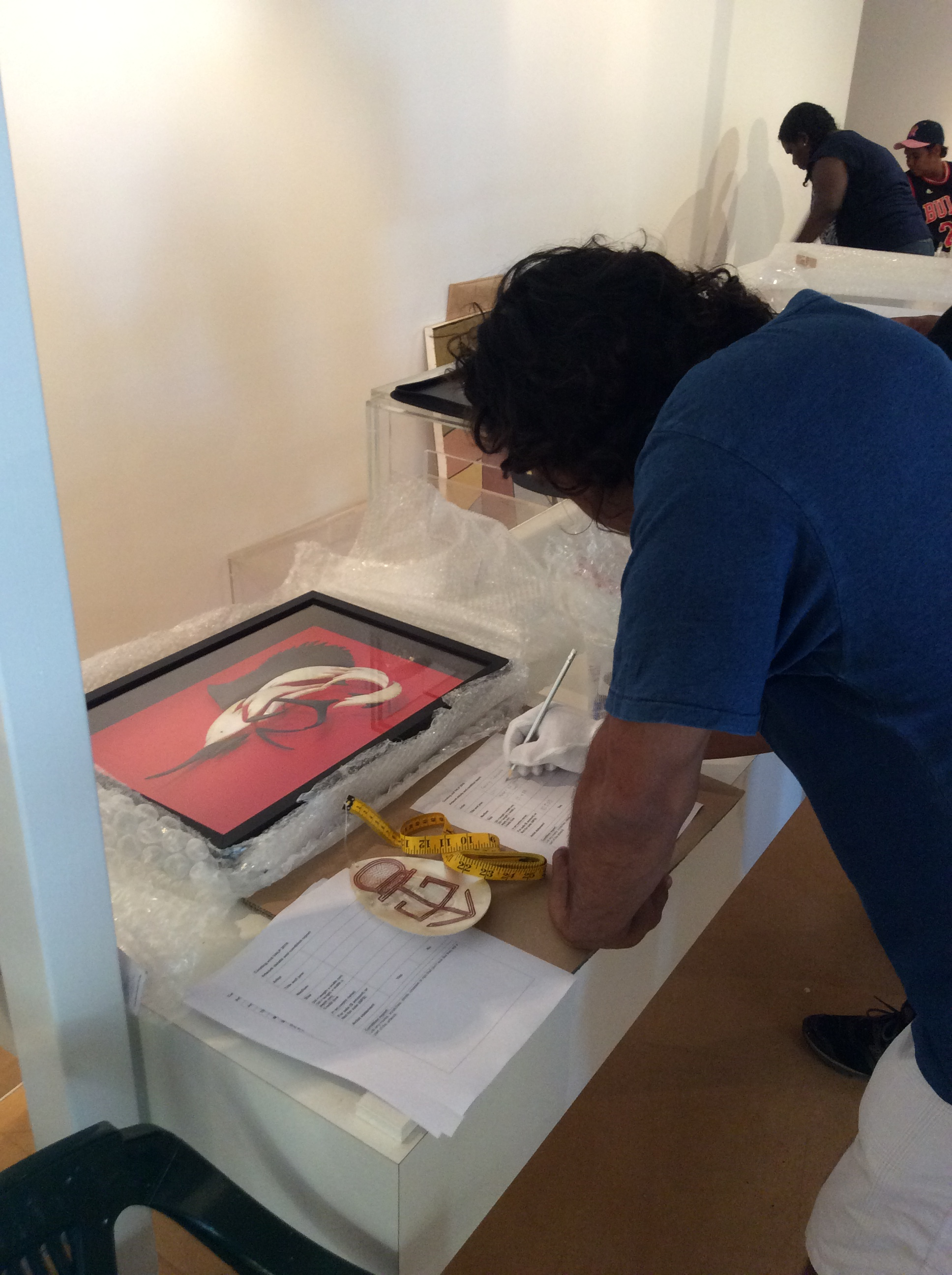 Visual Arts Leadership Program participant Garry Sibosado writing a condition report during the 2016 curating workshop for the inaugural Desert River Sea exhibition opening in Kununurra © AGWA