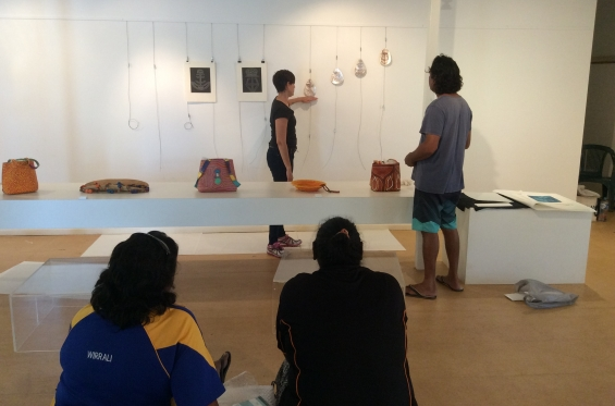Carly Lane, AGWA Curator of Aboriginal and Torres Strait Islander Art instructing DRS 2016 Visual Arts Leadership Program participant Garry Sibosado on exhibition install techniques with Selena O�Meara and Kirsty Burgu observing. © AGWA