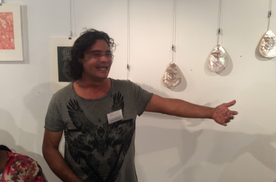 DRS 2016 Visual Arts Leadership Program participant Garry Sibosado at the inaugural VALP exhibition opening standing with artworks from Lombadina that he helped curate and install. © AGWA