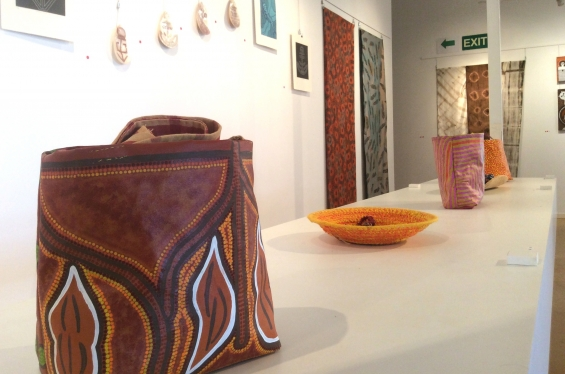 Install shot of the DRS 2016 Visual Arts Leadership Program exhibition in Kununurra with acrylic on canvas bag by Ngurra Arts artist Latoya Lawford in the foreground. © AGWA