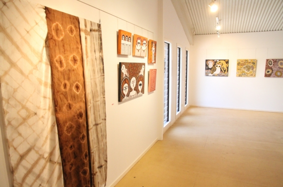 Install shot of the DRS 2016 Visual Arts Leadership Program exhibition in Kununurra with dyed textiles by Marnin Studio artists Amanda Smith and June Smith in the foreground. © AGWA