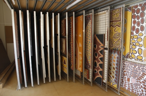 Artworks by deceased artists in the collection storage racks at Waringarri Aboriginal Arts Centre in Kununurra © AGWA 2012