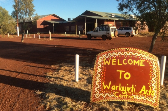 The welcome sign at the entrance to Warlayirti Artists Aboriginal Corporation Art Centre in Balgo. © AGWA 2016