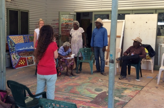 DRS Indigenous Community Liaison and Project Coordinator, Philippa Jahn talking with Mangkaja Arts Resource Agency artists and staff in Fitzroy Crossing. © AGWA 2016