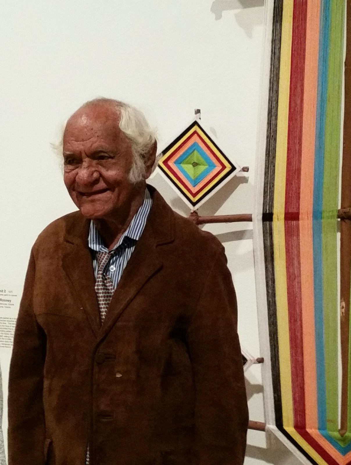Alan Griffiths standing next to his Balmoora exhibited at AGWA for the 2015 State Living Treasures Award ceremony © Waringarri Aboriginal Arts 2015