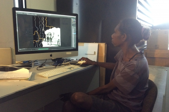 Arts worker Nancy Daylight at the Warmun Art Centre Media Lab assisting with work on animations. Oct 2017 © AGWA