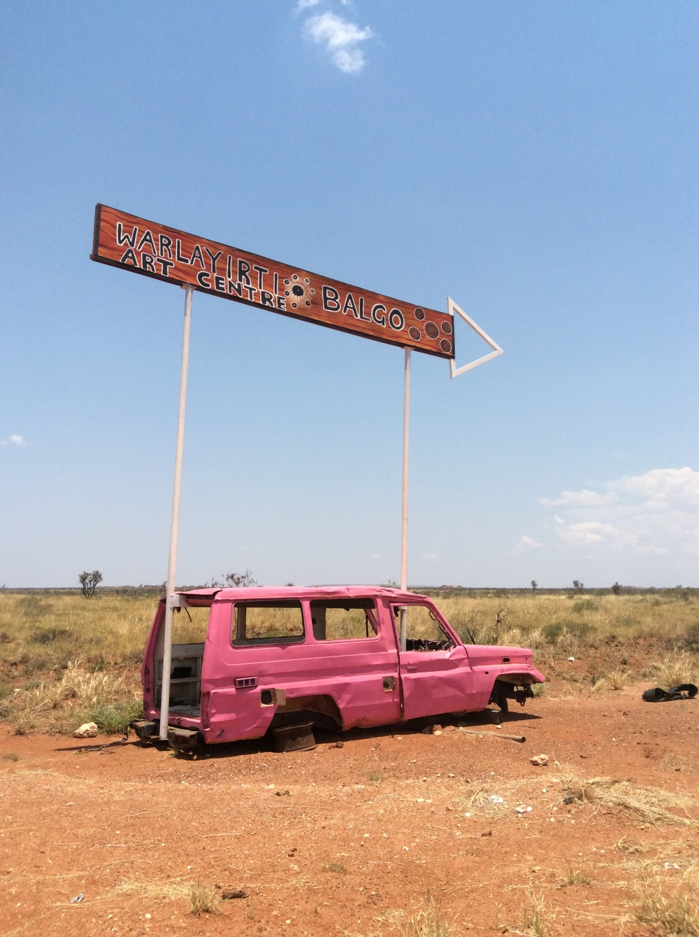 Sign to Warlayirti Art Centre at Tanami and Balgo road junction. Balgo, Nov 2017 © AGWA