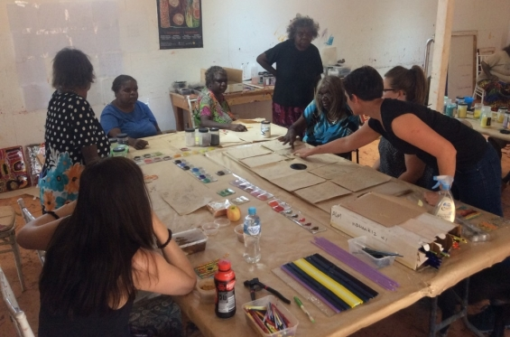 AGWA curator Carly Lane and glass workshop facilitator Bethany Wheeler working with Warlayirti artists brainstorming the collaborative bush tucker themed glass artwork. Balgo, Nov 2017 © AGWA
