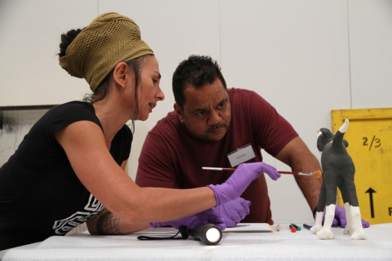 Michael Torres with Fiona Gavino at the art handling workshops, Art On The Move, 2013 Emerging Leaders Symposium.