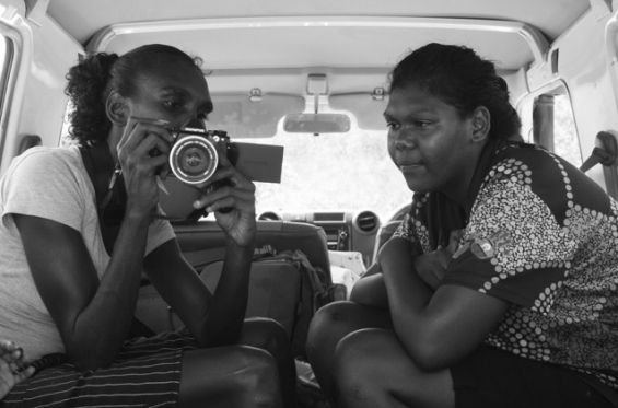 Zerika Clement and Justina Clement reviewing photos. © Clare Wood 2017