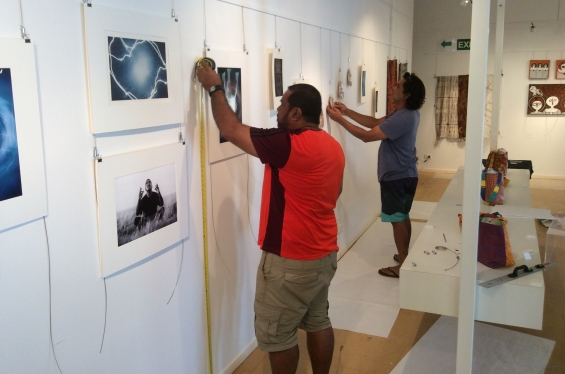 DRS Visual Arts Leadership Program participants Michael Jalaru Torres and Garry Sibosado during the 2016 workshop hanging artworks for the inaugural VALP exhibition. © AGWA