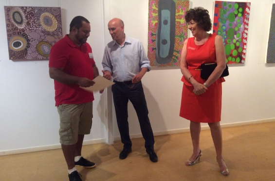 DRS Visual Arts Leadership Program participant Michael Jalaru Torres chatting with and receiving his course completion certificate from Stefano Carboni, AGWA Director and Lynne Hargreaves, Director of Exhibitions. © AGWA