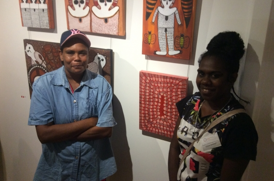 DRS 2016 Visual Arts Leadership Program participants Lutisha Woolagoodja and Cessa Bani at the inaugural VALP exhibition opening standing with works from Mowanjum Art & Culture Centre that they helped Curate and install. © AGWA