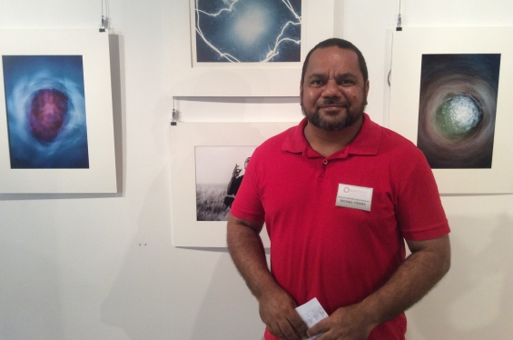 DRS 2016 Visual Arts Leadership Program participant Michael Jalaru Torres from Broome at the inaugural VALP exhibition opening standing with his own artworks that he helped curate and install. © AGWA